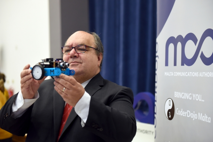 Minister Manuel Mallia inspecting a robot